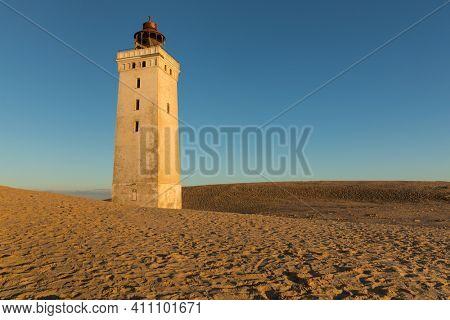 The abandoned lighthouse of Rubjerg Knude, near Lønstrup,  Denmark, in golden evening sunlight