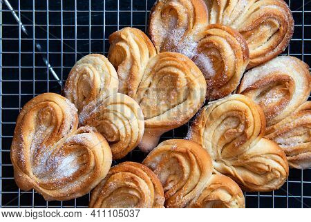 Homemade Palmier Puff Pastry. Delicious French Palmier Cookies With Sugar On A Cooling Rack. Palmier