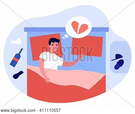 Man Depressed About Breakup. Unhappy Divorcee With Heartbreak, Lying In Bed, Drinking Alcohol. Flat