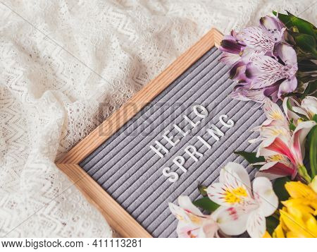 Letter Board With Season Greeting Hello Spring On Laces White Textile Background With Fresh Alstroem