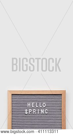 Grey Letterboard With Seasons Greeting Hello Spring And Symbol Of Usa Dollar. Vertical Banner With C