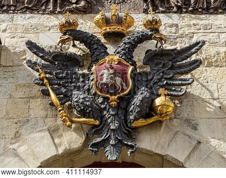 Double-headed eagle - the old coat of arms of the Russian Empire on gate of Peter and Paul Fortress in St. Petersburg, Russia