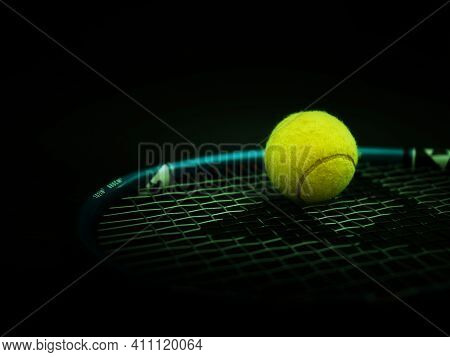 Sport And Healthy Lifestyle. Tennis. Yellow Ball For Tennis And A Racket On Table. Sports Background