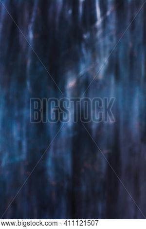 Unfocused Dramatic Blurred Abstract Of  An Eerie Dark, Blue Toned Texture Or Background.