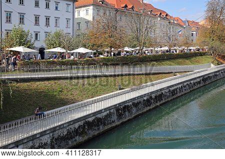 Ljubljana, Slovenia - October 12, 2014: People At Antique Market Along Ljubljanica River Sunday Mark