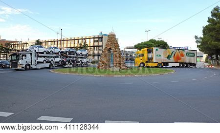 Koper, Slovenia - October 14, 2014: Transport Truck In Front Of Main Gate To Cargo Terminal And Comm