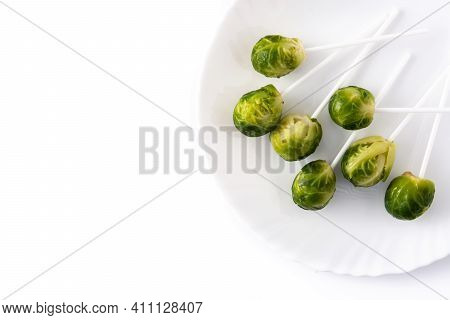 Set Of Brussel Sprouts With Lollipop Sticks Isolated On White Background. Top View. Copy Space
