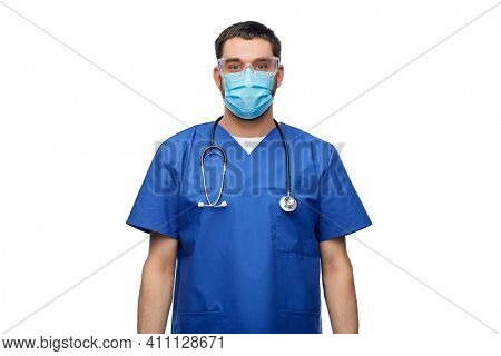 healthcare, profession and medicine concept - doctor or male nurse in blue uniform, face protective medical mask for protection from virus disease and goggles with stethoscope over white background