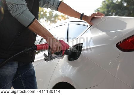Man Refueling Car At Self Service Gas Station, Closeup
