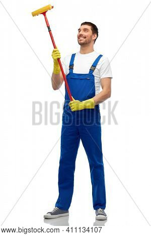 profession, service and people concept - happy smiling male worker or cleaner in overall and gloves with window cleaning mop over white background