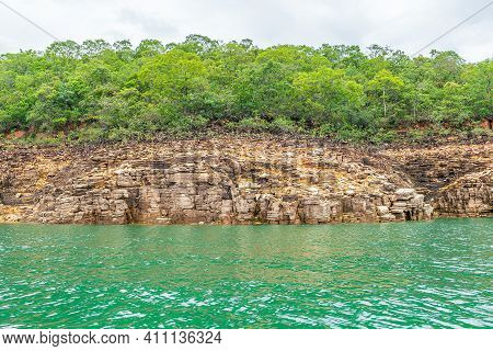 Rock Walls Of On The Shore Of The Lake Of Furnas, Capitólio Mg, Brazil. Green Water Of The Lake, Sed