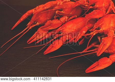 Shellfishes Delicious Lunch. Cooked Red Crayfishes On Black Stone Background. Red Boiled Crayfishes