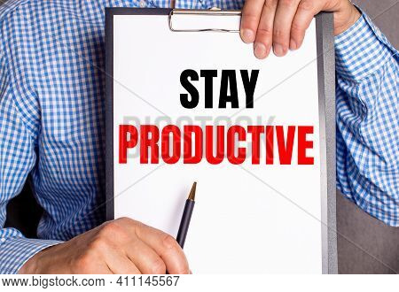 The Man Points With A Pen To The Text Stay Productive On A White Sheet.