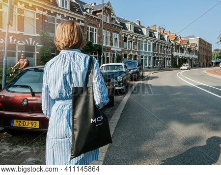 Haarlem, Netherlands - Aug 21, 2018: Rear View Of Beautiful Dutch Woman Walking On The Large Dutch S