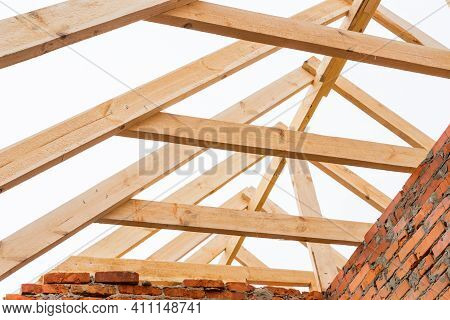 Installation Of Wooden Beams At Construction The Roof Truss System Of The House.