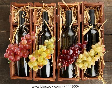 Wooden case with wine bottles on wooden table