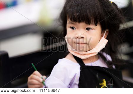 Students Intend To Study Art In Class. Children Wear A Cloth Mask Under Their Chin. Child Put On The
