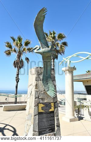HUNTINGTON BEACH, CA - MARCH 25, 2015: Pelican Statue Lifeguard Memorial. The monument honors former Chief Lifeguard Vincent G. Moorehouse.