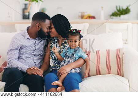 Happy Married Couple At Home With Baby Daughter, Family Relations