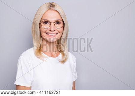 Portrait Of Blond Optimistic Old Lady Near Empty Space Wear Spectacles White Cloth Isolated On Grey