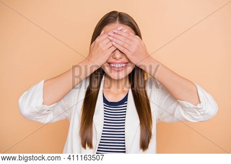 Photo Of Young Happy Positive Cheerful Smiling Good Mood Woman Cover Eyes With Hands Isolated On Bei