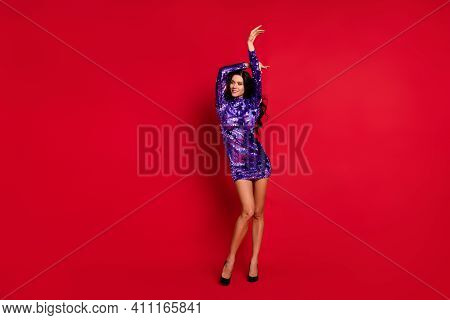 Full Body Photo Of Calm Charming Woman Raise Hands Look Empty Space Wear Stilettos Isolated On Red C