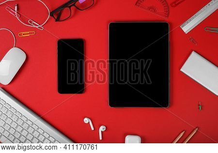 Mockup Of Smart Gadgets On The Background Of Office Items On Red Background. Computer Mouse And Keyb