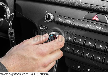 The Process Of Choosing Climate Control In The Car. Man Regulating Temperature On Car Air Condition.