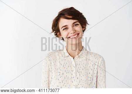 Candid Portrait Of Young Beautiful Woman Smiling Happy At Camera, Looking Friendly, Standing On Whit