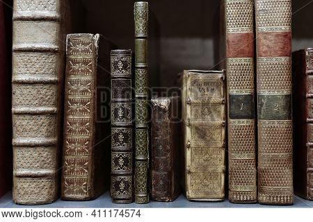 Old Worn Books On A Shelf In The Librarys Shelfs