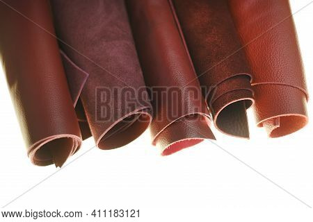 Genuine Leather Isolated On White Background.red And Burgundy Genuine Leather In Rolls On A White Ba