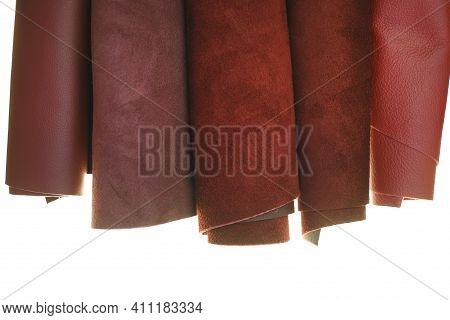 Genuine Leather Isolated On White Background.burgundy Genuine Leather In Rolls Close-up On A White B