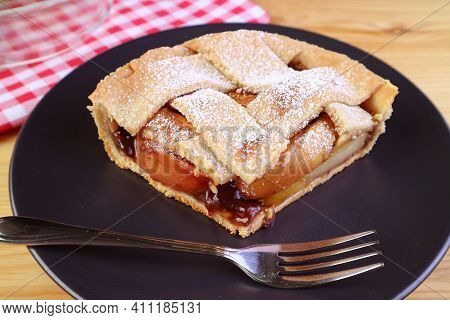 Slice Of Mouthwatering Homemade Apple Pie On Black Plate