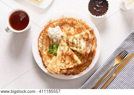 Russian Traditional Breakfast For Shrovetide Of Thin Pancakes Or Blini With Cholate And Tea On White