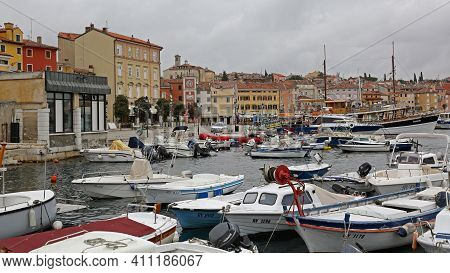 Rovinj, Croatia - October 15, 2014: Many Boats At Marina Port And Picturesque Colourful Houses In Ro