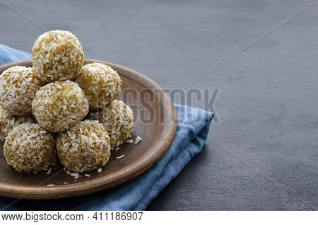 Home Made Nutritional Energy Balls Consisting Of Nuts, Oatmeal, Honey, Dried Fruits On A Clay Plate