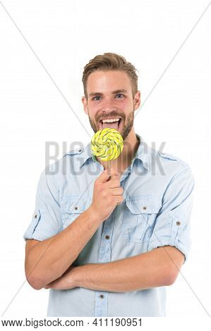 Lick It. Man Handsome Bearded Guy Smiling While Licking Candy. Guy Cheerful Smile Macho Feels Happy
