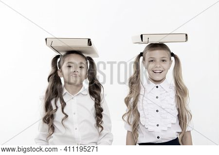 Proper Posture. Schoolgirls With Cute Pony Tails Hairstyle Carry Folders On Heads. Perfect Schoolgir