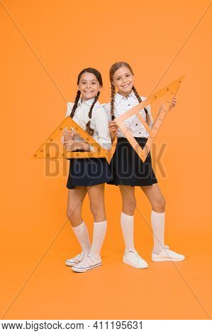 School Students Study Geometry. Pupil School Girls Big Rulers. School Knowledge. Explore World With
