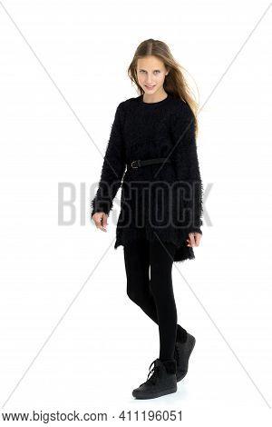 Stylish Teenage Girl With Long Hair Flying On Air. Beautiful Fashionable Girl Wearing Black Warm Elo