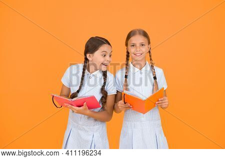 Reading And Retelling. Small Children Holding Books Yellow Background. Sincere Interest. Little Girl