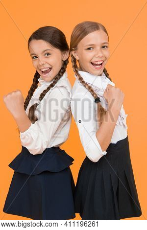 Best Pupils Award. Excellent Pupils. Girls Perfect Uniform Outfit On Yellow Background. Making Every