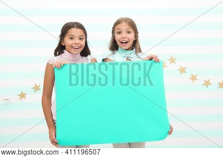 Kids Make Advertisement. Advertising Your Product. Smiling Little Girls Kids Hold Blue Advertisement