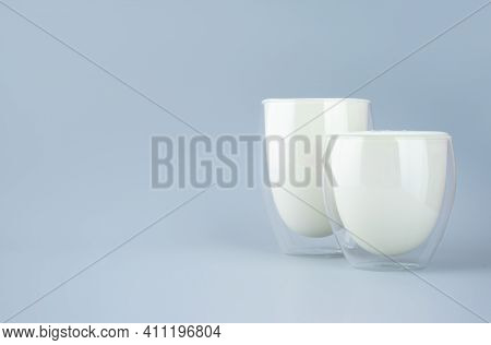 Probiotic Drink, Buttermilk Or Yogurt. Kefir In Glass On Minimalistic Blue Background. Bacteria Gut