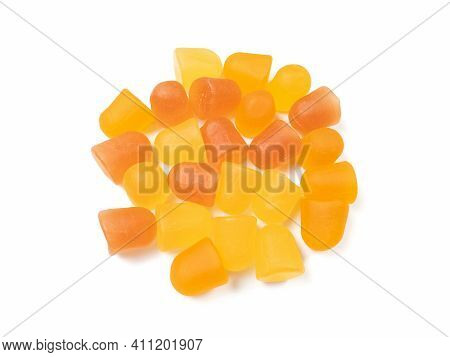 Close-up Texture Of Orange And Yellow Multivitamin Gummies. Healthy Lifestyle Concept.