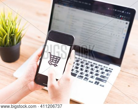 Online Shopping Website On Laptop.