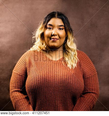 Woman With Burnt Orange Sweater Smiles
