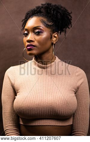 Black Woman With Natural Hair Wearing A Crop Top