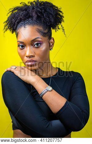 Black Woman With Natural Hair Wears Black Crop Top