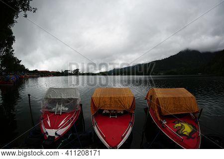Magetan, Indonesia. December 21, 2020. Cloudy Morning At The Edge Of The Sarangan Lake. Three Red Mo